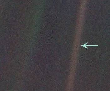 A photograph of the Earth taken by Voyager 1 from the outer Solar System, famously known as the 'Pale Blue Dot'. It was taken on the request of Carl Sagan, who was part of the team working on the Voyager missions.